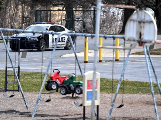 A police car is parked outside Canadochly Elementary School following a reported bomb threat at one of the schools in the Eastern York School District.