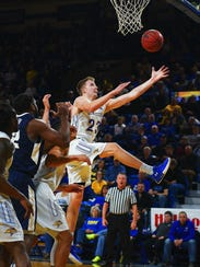 SDSU's Reed Tellinghuisen tries to rebound the ball