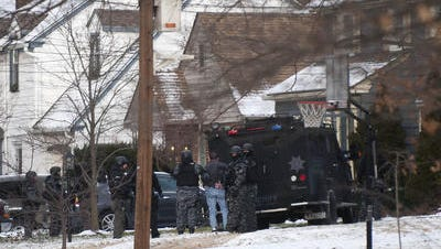 A man is brought out of a home on Addison Avenue in Haddon Township by members of the Camden County Sheriff's Department SWAT Team on Wednesday, January 7, 2015