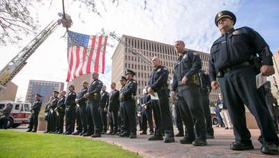 Police officers line up during the annual ceremony to honor municipal employees outside Phoenix City Hall on Thursday, Feb. 19, 2015.
