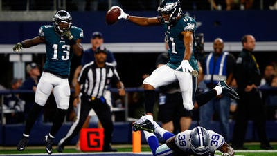 Jordan Matthews celebrates his game-winning touchdown   in overtime last Sunday against the Dallas Cowboys.