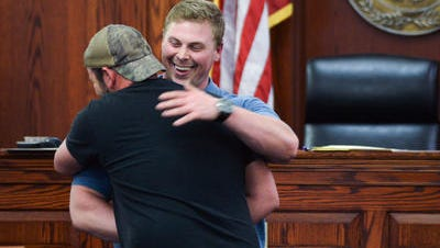 Doug Bryant, 27, of Boone County, facing, is congratulated for his graduation from drug court at the Boone County Justice Center.  Doug Bryant, 27, of Boone County (facing) is congratulated for his graduation from drug court at the Boone County Justice Center on April 6.