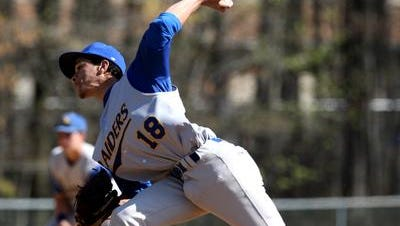 Placido Torres pitching for North Brunswick High School against Monroe in an Apirl 2012 game.