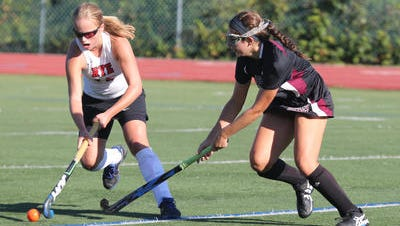 Rye's Fusine Govaert (l), shown moving the ball against Scarsdale last year, is one of the elite players in New York.