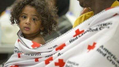 Anthony Hicks III, 1, sits with his family in August at a Red Cross shelter at the Kokomo Event Center a day after a tornado displaced his family and others in the central Indiana town.  Aug. 25, 2016