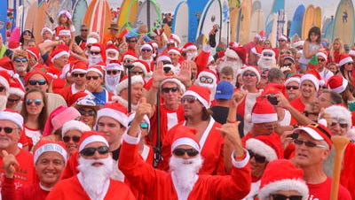 Surfing Santas as far as you could see. More than 6000 people showed up to watch hundreds of surfing Santas take to the waves in Cocoa Beach last year.  This year founder and event organizer George Trosset said 10,000 spectators and 1,000 surfers could be possible.