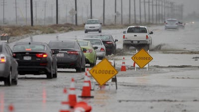 FILE - Traffic was backed up on Indian Canyon Drive during a storm late December 2016.