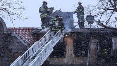 White Plains firefighters use ladder truck to help Firefighters last month put out a fire in a congested area of Mamaroneck Avenue in January.