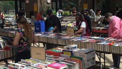 Shoppers browsed the thousands of books available at the used book sale at the Robert and Janet Bennett branch of the Livonia Public Library in this May 2016 file photo. The Friends announced that the most recent sale pushed overall sales past $2 million since 1989.