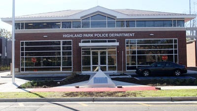 An off-duty Highland Park police officer has been charged with driving under the influence of alcohol in a crash that injured two people.