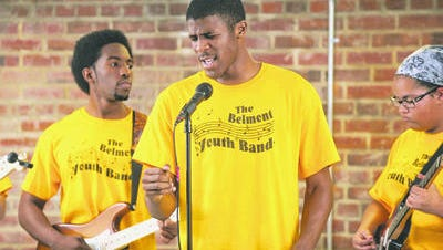 Ke'shon Lewis sings with the Belmont Youth Band in this photo from 2013. Today, Lewis still volunteers today with the Belmont Youth Band, which is seeking new members.