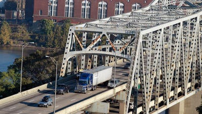 Northern Kentucky officials oppose tolls for funding a new Brent Spence Bridge, but business leaders on both sides of the river support their use.