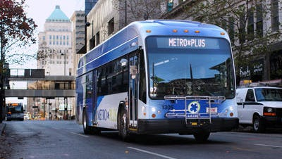 Support for Cincinnati's Metro bus system comes from the city's earnings tax. Shown is one of the Metro Plus buses north on Main Street. Metro's rapid transit lines between Blue Ash and Uptown are doing well, according to bus officials.
