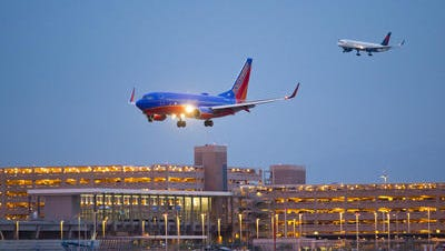 A Southwest Airlines planes lands at Sky Habor International Airport in Phoenix.