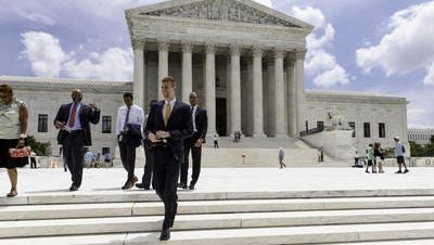 People leave the Supreme Court in Washington, Thursday, June 26, 2014, in the final days of its term. The Supreme Court says public sector unions can't collect fees from home health care workers who object to being affiliated with a union.