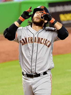 Brandon Crawford hits a solo home run in the fourth inning.