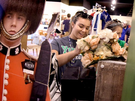 York College freshmen and Graham Scholars Jordan Manion of Springfield, Virginia, left, and Kasey Drzewiecki of Baltimore County, Maryland, look at items in Redeux while taking a tour of downtown York with classmates Thursday, August 25, 2016. Students in the Graham Innovation Scholar program and the Eisenhart Community Scholars from the college participated in the tour. Bill Kalina photo