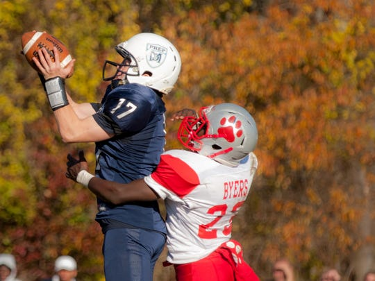 Mater Dei Prep's Kyle Devaney (17) makes a 33 yard reception during the Seraphs' 26-0 win over St. Joseph on Saturday.