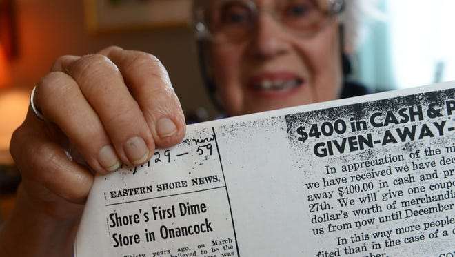 Jo Penland of Accomac, Va. holds a copy of an Eastern Shore News newspaper clipping from 1959 about a story on her father's business in Onancock, which was believed to be the first independent dime store on the Delmarva Penninsula in 1929.