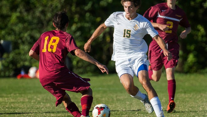 St. Mark's Matthew Theodorakis (No. 15) cuts past St. Elizabeth's Benjamin Bryan (No. 18) in the first half of St. Mark's 2-1 win over St. Elizabeth's at St. Mark's High School on Thursday afternoon.