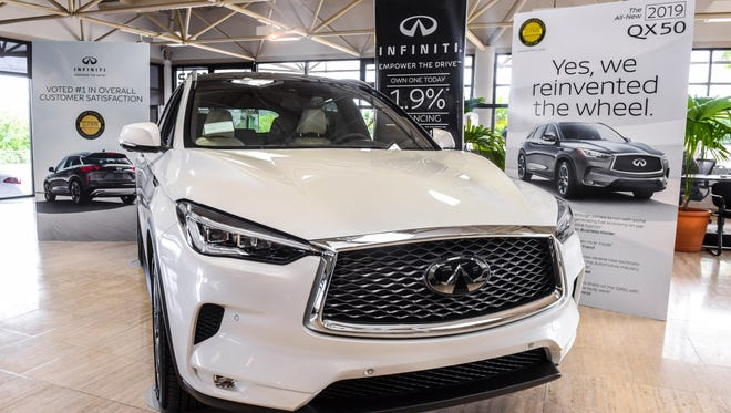 Nissan Motor Corporation in Guam introduces the 2019 Infiniti QX50 during a walk through and test drive for the vehicle at its upper Tumon showroom on Friday, June 22, 2018. Nissan promotes the QX50 as the first automobile to be powered by the world's first production-ready variable compression turbo engine.
