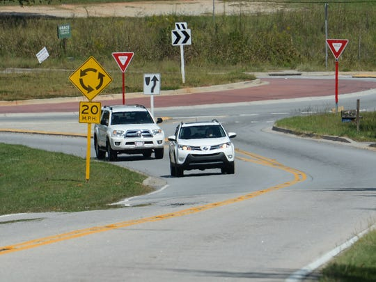 Cars drive through the roundabout on U.S.178 in Liberty last month.