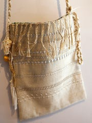 Woven handbag by artist Donna Hudson that is part of