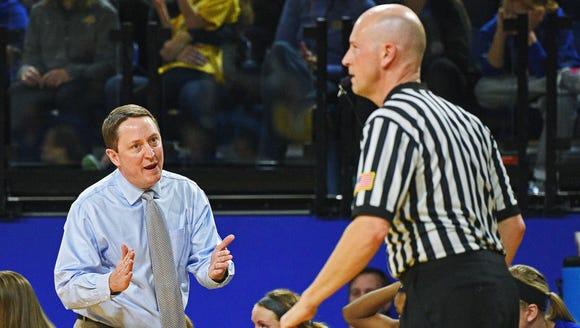 SDSU head women's basketball coach Aaron Johnston speaks