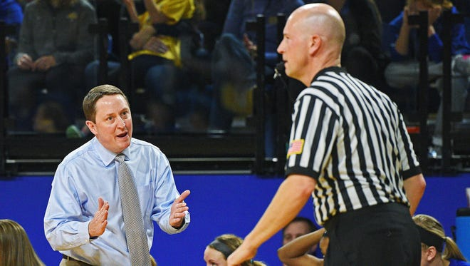 SDSU head women's basketball coach Aaron Johnston speaks with an official during a game against Western Illinois Saturday, Jan. 21, 2017, at Frost Arena on the South Dakota State University campus in Brookings, S.D.