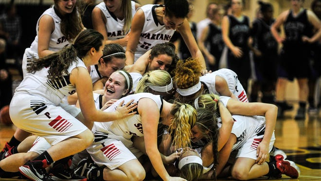 The Pleasant girls basketball team celebrates after its 52-51 double overtime victory over Bishop Ready Friday night at Ohio Dominican. The Spartans will play in the regionals for the first time since 2009 when they go to Springfield High School to face Bethel-Tate Wednesday at 6:15 p.m.