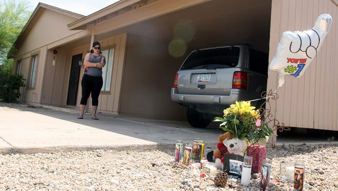 Carolina Viniegra visits the memorial site where 16-year-old Miguel Navarro was shot and killed Sunday, April 17, 2016.