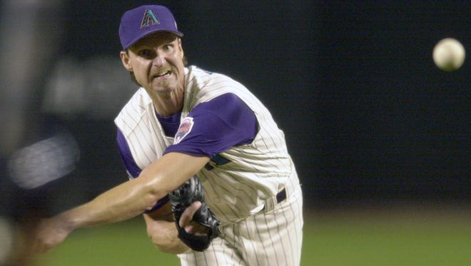 Arizona Diamondbacks pitcher Randy Johnson throws against the New York Yankees in the first inning of Game 6 of the World Series at Bank One Ballpark in Phoenix on Nov. 1, 2001.