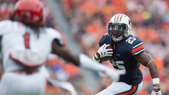 Auburn Tigers running back Peyton Barber (25) runs downfield during the first half of the NCAA Auburn vs. Jacksonville State on Saturday, Sept. 12, 2015, in at Jordan-Hare Stadium in Auburn, Ala.