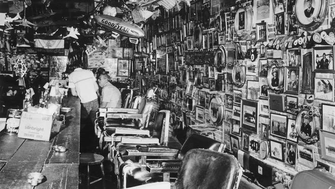 Pictures and memorabilia covered the walls and ceiling of Trader Jon's. Celebrities passed through the doors and so did the not-so-well-known, from Naval students to beach visitors.