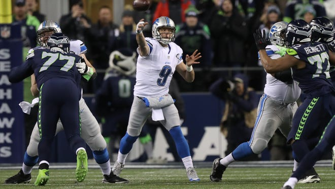 Lions quarterback Matthew Stafford passes against the Seahawks during the first quarter Saturday in Seattle.