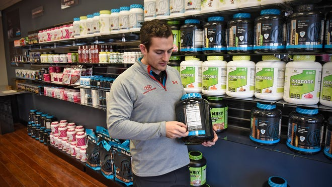 All Star Nutrition owner Dan Marver talks about some of the products offered Thursday, Jan. 27, at the store in Waite Park.