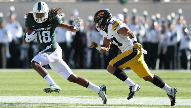 Michigan State's Felton Davis III catches a pass against Iowa's Amani Hooker during the first quarter on Saturday, Sept. 30, 2017, at Spartan Stadium in East Lansing.