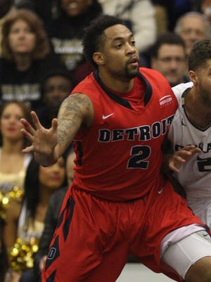 The Oakland Golden Grizzlies Dante Williams defends against the Detroit Titans Juwan Howard Jr.during first half action on Sunday, February 15, 2015 the Athletics Center O'Rena in Auburn Hills.