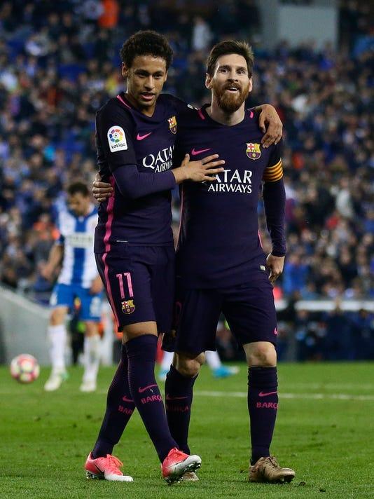 FC Barcelona's Lionel Messi, right, and Neymar celebrate a goal during the Spanish La Liga soccer match between Espanyol and FC Barcelona at RCDE stadium in Cornella Llobregat, Spain, Saturday, April 29, 2017. (AP Photo/Manu Fernandez)