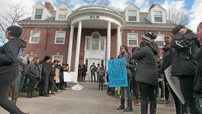 Student protesters gather outside the Douglass Leadership House before marching across campus at the University of Rochester on Friday.