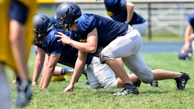 Players for the Port Huron Northern Huskies run drills during practice on Aug. 14.