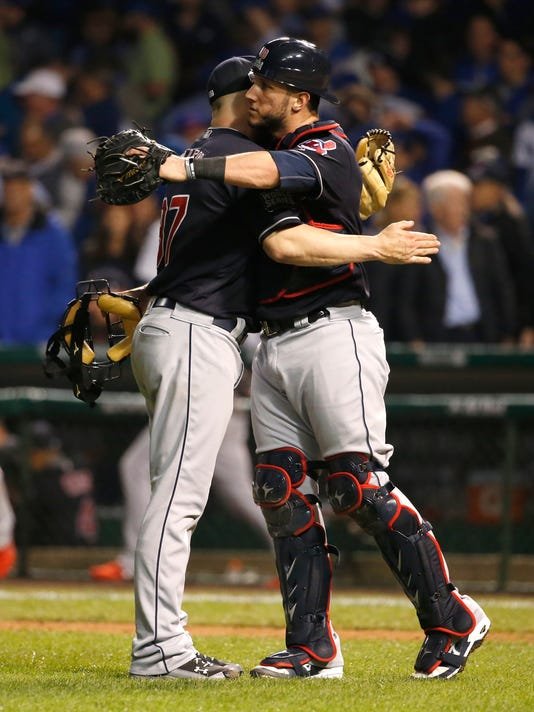 Cleveland Indians relief pitcher Cody Allen, left, cebrates with catcher Yan Gomes after Game 3 of the Major League Baseball World Series against the Chicago Cubs, Friday, Oct. 28, 2016, in Chicago. The Indians won 1-0 to take a 2-1 lead in the series. (AP Photo/Nam Y. Huh)