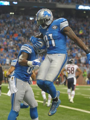 Tim Wright, left, and Calvin Johnson celebrate Wright's first touchdown as a Detroit Lion in the second quarter Sunday.