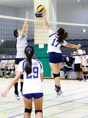 St. Paul Christian School Warriors' Darby Samala, (17) at the Asian Christian Schools' Conference High School Girls Volleyball Tournament at the Yongsan International School in Seoul. Samala was named to the all-tournament team.