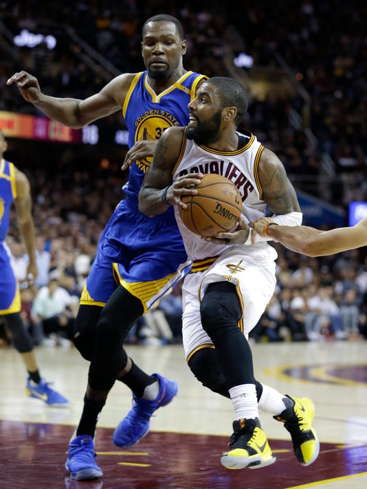 Cleveland Cavaliers guard Kyrie Irving drives on Golden State Warriors forward Kevin Durant (35) during the second half of Game 3 of basketball's NBA Finals in Cleveland, Wednesday, June 7, 2017. Golden State won 118-113. (AP Photo/Tony Dejak)