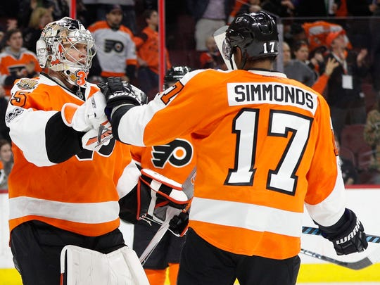 Philadelphia Flyers' Steve Mason, left, celebrates