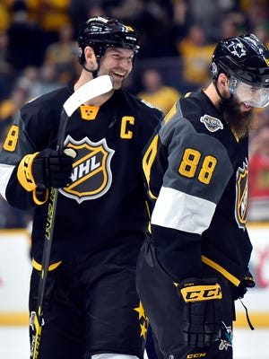 John Scott and Brent Burns celebrate their victory in the NHL All-Star Game in Nashville.