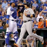 Tigers DH Victor Martinez runs home past Royals catcher Salvador Perez to score on a single by Eugenio Suarez during the first inning of the Tigers' 10-1 win Friday in Kansas City, Mo.