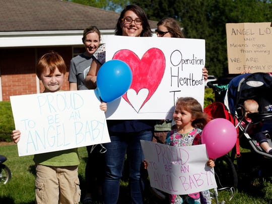 Jodi Libasci stands across from Angel Medical Center with her children, Brody, 7, and Arleigh, 3, in protest of the loss of labor and delivery services in Macon County in this May 2017 photo.