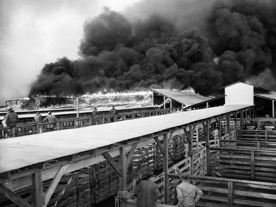 A view of the Union Stockyards fire. Black smoke and